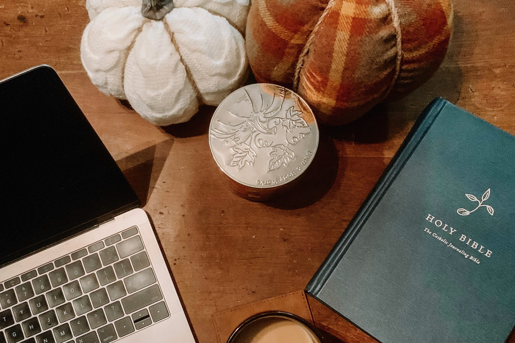 a photo of my laptop, stuffed pumpkins, coffee and my bible