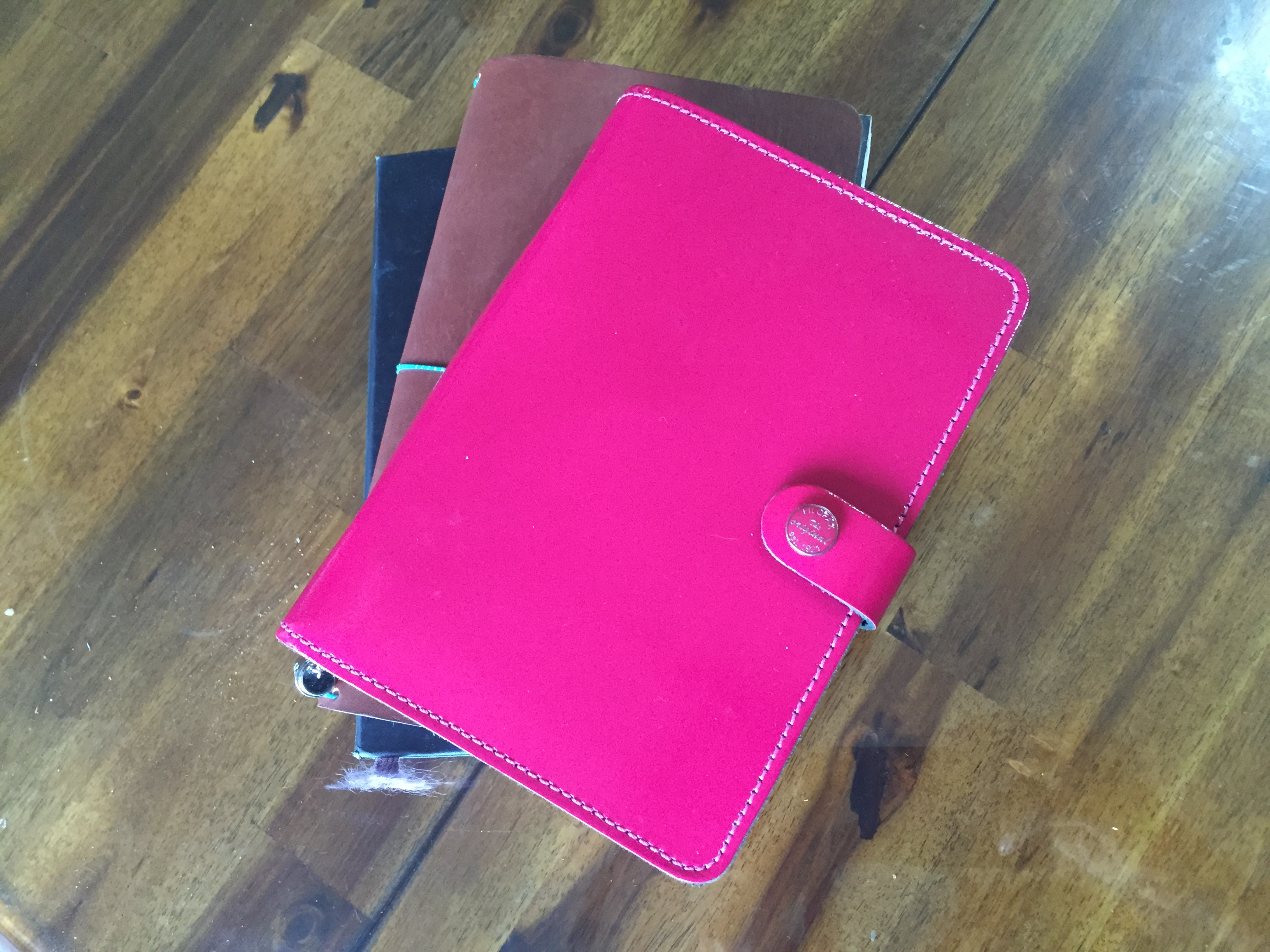 These are the Fauxdori, Moleskine, and personal size Filofax original patent in fuchsia.