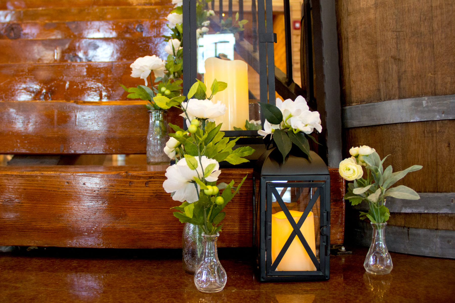 flowers, candles and lanterns on stairs from wedding
